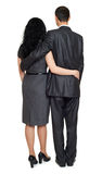 Couple embrace backside, rear view, studio portrait on white. Dressed in black suit. royalty free stock photography