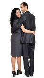 Couple embrace backside, rear view, studio portrait on white. Dressed in black suit. stock photos
