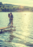 Couple embrace on the pier Stock Photography
