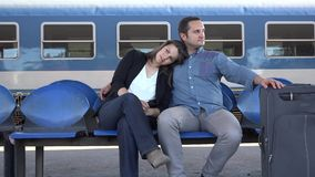Couple embraced waiting in train station, happy travel, new life, man and woman smiling. 4K stock video