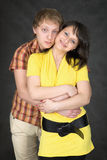 Couple embraces on a black background Royalty Free Stock Images