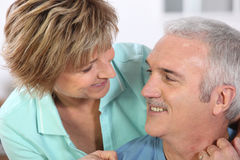 Couple embracing. Middle-aged couple affectionately embracing Stock Photography