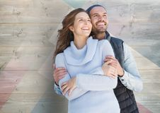 Couple embracing against wooden background Royalty Free Stock Photo