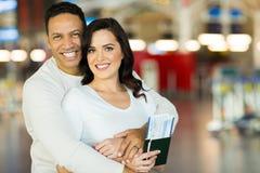 Couple embracing airport Stock Photos