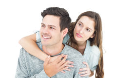 Couple embracing with arms around and looking away Royalty Free Stock Photo