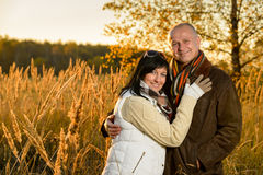 Couple embracing in autumn countryside sunset Royalty Free Stock Photo