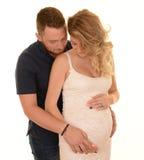 Couple embracing baby bump Stock Photography
