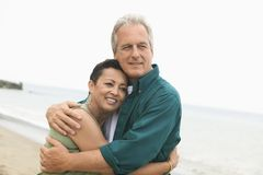 Couple embracing on beach Stock Photo