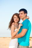 Couple embracing on beach Royalty Free Stock Images