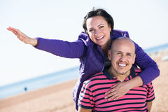 Couple embracing on the beach Stock Images