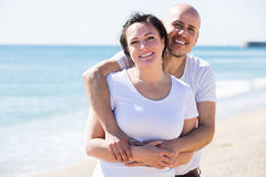 Couple embracing on the beach Stock Photo
