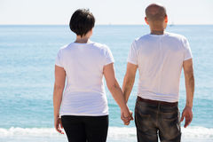 Couple embracing on the beach Stock Image