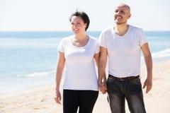 Couple embracing on the beach Stock Photos