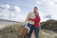 Couple Embracing On Beach Royalty Free Stock Photos