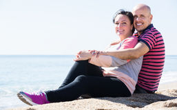 Couple embracing on the beach Stock Photography