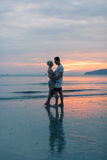 Couple Embracing On Beach At Sunset, Young Tourist Man And Woman Hug On Seaside Stock Photography