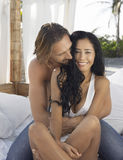 Couple Embracing On Bed In Gazebo Stock Images