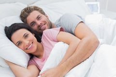 Couple embracing in bed Royalty Free Stock Image