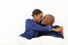 Couple embracing bed Royalty Free Stock Photo