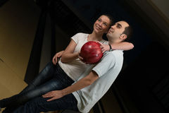 Couple Embracing At The Bowling Alley Stock Photos