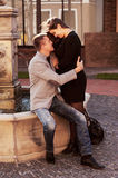 Couple embracing. Boyfriend and Girlfriend. Warm evening sunlight. Official dress code stock image