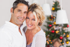 Couple embracing at christmas Stock Photo