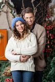 Couple Embracing At Christmas Store Royalty Free Stock Photos
