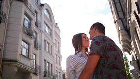 Couple embracing on the city buildings background stock video footage