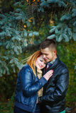 Couple embracing in city park Stock Images