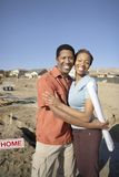 Couple Embracing At An Construction Site Royalty Free Stock Photography