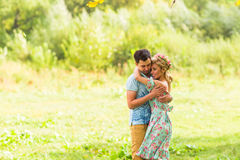 Couple embracing on the countryside. Young romantic man and woman standing and hugging each other with tenderness on Royalty Free Stock Photos