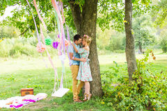Couple embracing on the countryside. Young romantic man and woman standing and hugging each other with tenderness on Royalty Free Stock Images