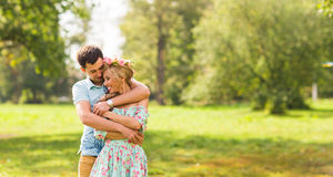 Couple embracing on the countryside. Young romantic man and woman standing and hugging each other with tenderness on Royalty Free Stock Image