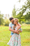 Couple embracing on the countryside. Young romantic man and woman standing and hugging each other with tenderness on Royalty Free Stock Photography