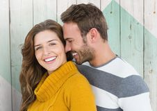 Couple embracing each other against wooden background Stock Photos