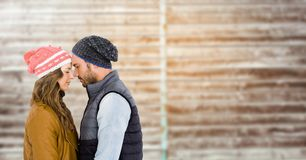 Couple embracing each other against wooden background Royalty Free Stock Images