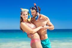 Couple embracing each other on beach Stock Photos