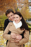 Couple embracing in fall Royalty Free Stock Images