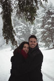 Couple embracing in forest during winter Royalty Free Stock Image