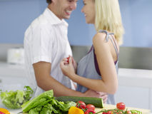 Couple Embracing With Fresh Vegetables On Kitchen Counter Stock Images