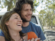 Couple Embracing In Front Of Campervan Royalty Free Stock Image