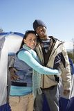 Couple Embracing In Front Of Camping Tent Stock Images