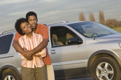 Couple Embracing In Front Of Car Royalty Free Stock Photo