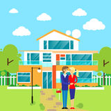 Couple embracing in front of new big modern house Royalty Free Stock Photo