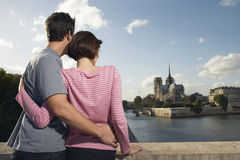 Couple Embracing In Front Of Notre Dame Cathedral Stock Photography