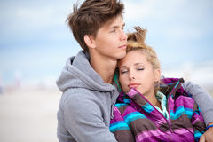 Couple embracing and having fun on beach Stock Photo