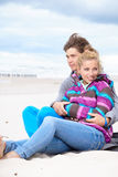 Couple embracing and having fun on beach Stock Photography