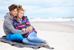 Couple embracing and having fun on beach Stock Photos