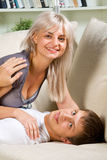 Couple embracing at home Stock Image