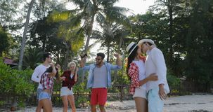 Couple Embracing Kiss Over People Group Dancing In Tropical Palm Tree Park Happy Men And Women On Vacation. Slow Motion 60 stock footage
